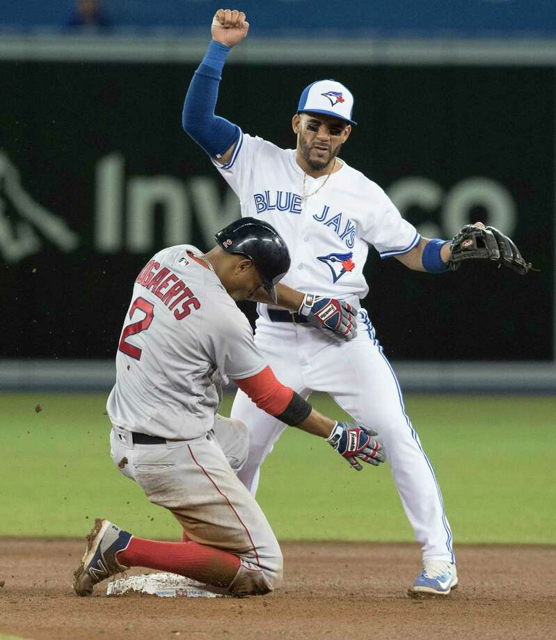 Boston Red Sox's Xander Bogaerts is forced out at second base but manages to keep Toronto Blue Jays' Devon Travis from turning the double play in the fifth inning of a baseball game Wednesday, April 19, 2017, in Toronto. (Fred Thornhill/The Canadian Press via AP) ORG XMIT: FJT111 Photo: Fred Thornhill / The Canadian Press