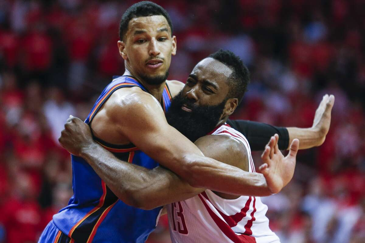 Houston Rockets guard James Harden (13) and Oklahoma City Thunder forward Andre Roberson (21) battle for positioning as the Houston Rockets beat the Oklahoma City Thunder 115-111 in Game 2 of the first-round playoff series Wednesday, April 19, 2017 in Houston at the Toyota Center. ( Michael Ciaglo / Houston Chronicle)