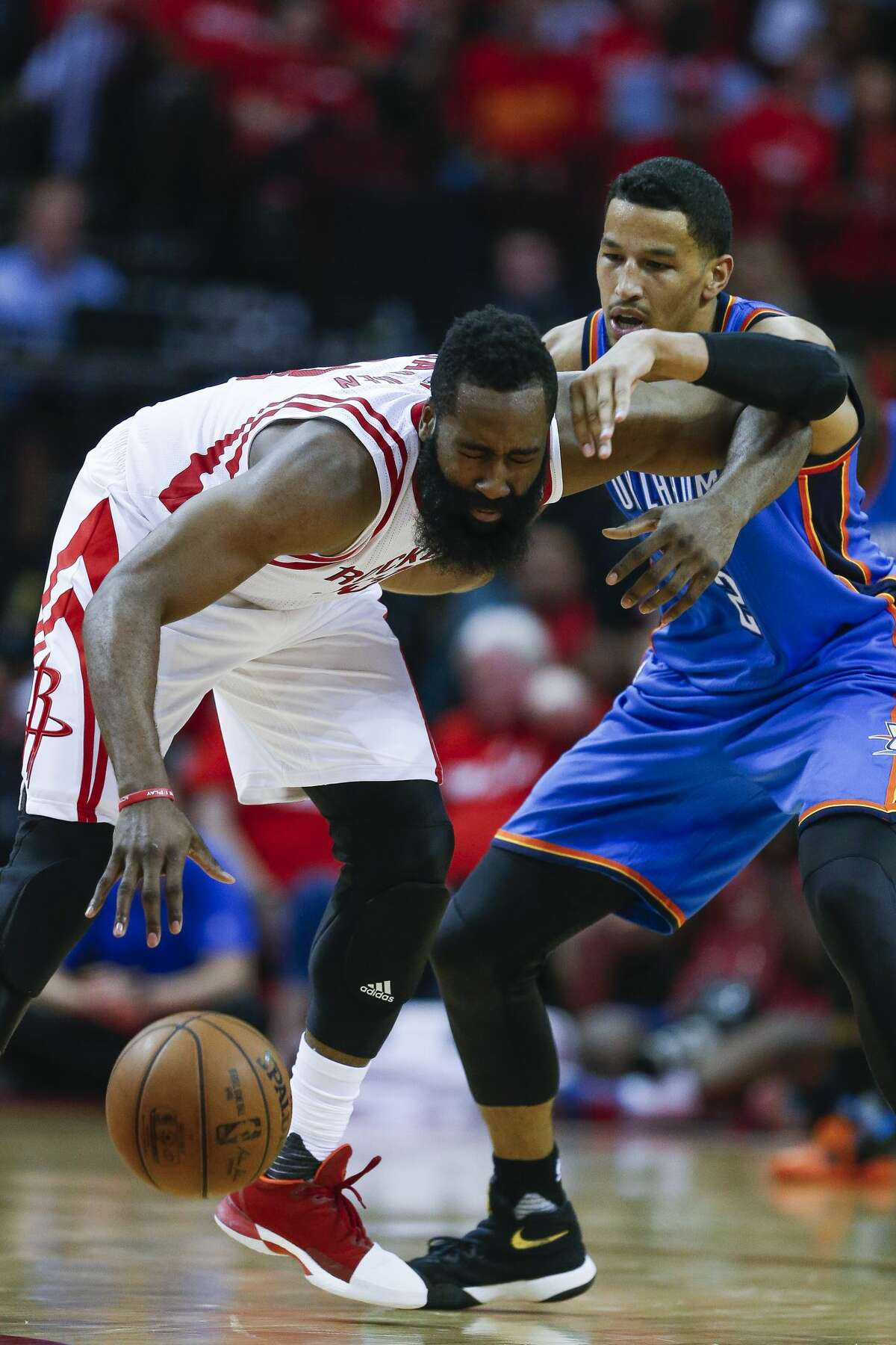 Houston Rockets guard James Harden (13) reacts as he gets tangled up with Oklahoma City Thunder forward Andre Roberson (21) as the Houston Rockets beat the Oklahoma City Thunder 115-111 in Game 2 of the first-round playoff series Wednesday, April 19, 2017 in Houston at the Toyota Center. ( Michael Ciaglo / Houston Chronicle)