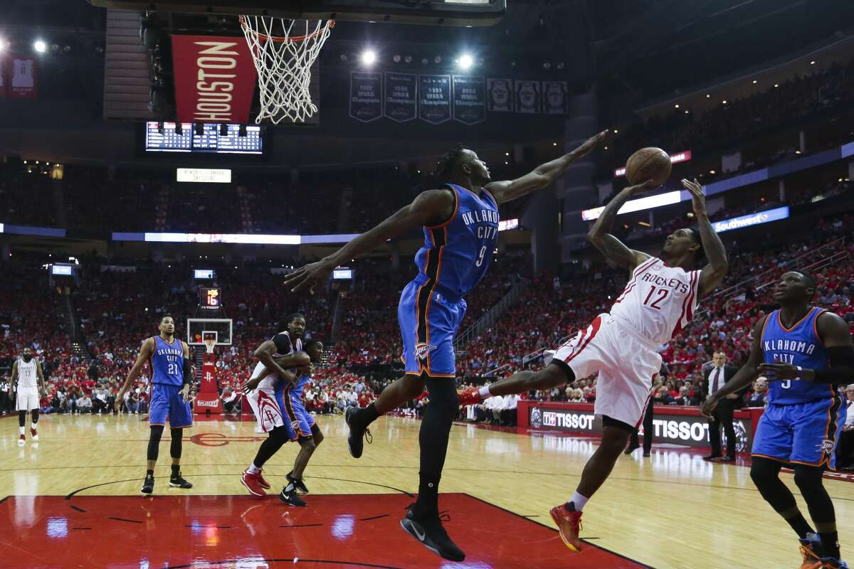 Houston Rockets guard Lou Williams (12) puts a shot up over Oklahoma City Thunder forward Jerami Grant (9) as the Houston Rockets beat the Oklahoma City Thunder 115-111 in Game 2 of the first-round playoff series Wednesday, April 19, 2017 in Houston at the Toyota Center. ( Michael Ciaglo / Houston Chronicle)