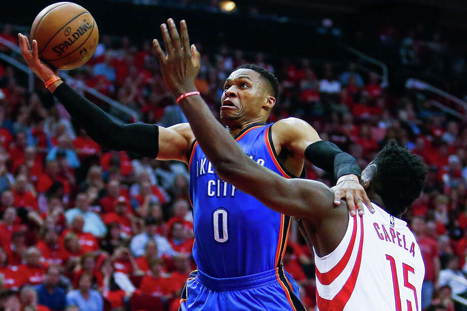 Thunder guard Russell Westbrook, left, let nothing, including Rockets center Clint Capela, get in his way to a 51-point performance and yet another triple-double Wednesday night in Game 2 at Toyota Center. Photo: Michael Ciaglo, Staff / Michael Ciaglo