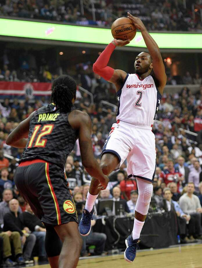 Washington Wizards guard John Wall (2) shoots against Atlanta Hawks forward Taurean Prince (12) during the first half in Game 2 of a first-round NBA basketball playoff series, Wednesday, April 19, 2017, in Washington. (AP Photo/Nick Wass) ORG XMIT: VZN106 Photo: Nick Wass / FR67404 AP