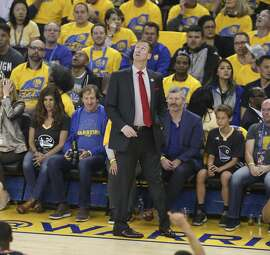 Portland Trail Blazers' Terry Stotts looks up at the scoreboard in the first quarter during Game 2 of the First Round of the Western Conference 2017 NBA Playoffs at Oracle Arena on Wednesday, April 19, 2017 in Oakland, Calif.