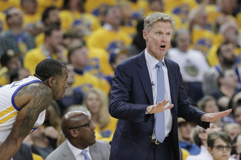 Golden State Warriors' Coach Steve Kerr talks to his players in the first quarter during Game 2 of the First Round of the Western Conference 2017 NBA Playoffs at Oracle Arena on Wednesday, April 19, 2017 in Oakland, Calif.