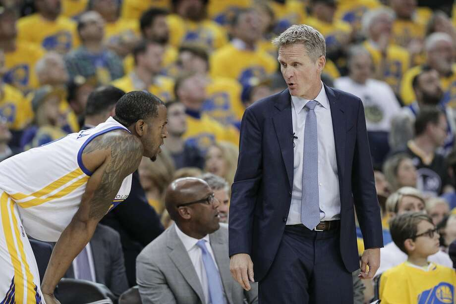 Steve Kerr talks to Andre Iguodala during Game 2 of the first round of the Western Conference playoffs at Oracle Arena. Photo: Carlos Avila Gonzalez, The Chronicle