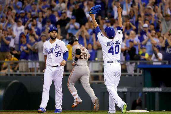 KANSAS CITY, MO - APRIL 19:  Eric Hosmer #35 and Kelvin Herrera #40 of the Kansas City Royals celebrate after the final out as the Royals defeat the San Francisco Giants 2-0 to win the game at Kauffman Stadium on April 19, 2017 in Kansas City, Missouri.  (Photo by Jamie Squire/Getty Images)