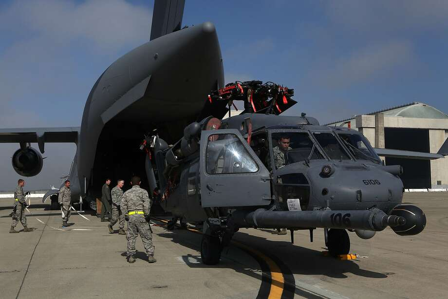 The 129th Rescue Wing of California Air National Guard at Moffett Field in Mountain View, Calif., is loading one of two HH6OG rescue helicopters in 2012. The helicopters were used to rescue an injured fisherman early Tuesday. Photo: Liz Hafalia, The Chronicle