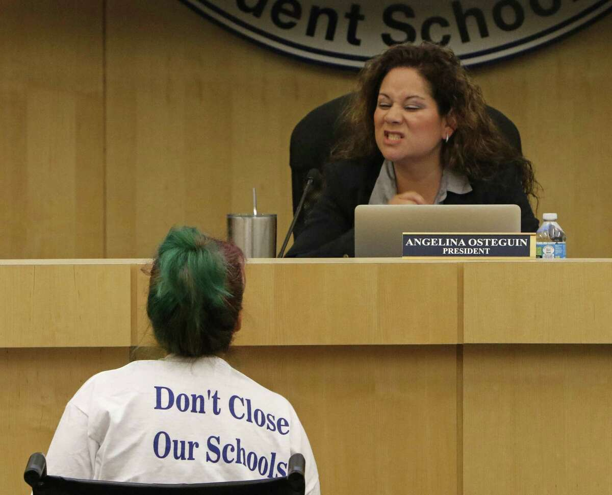 Stacey Alderete talks with board president Angelina Ostegun before the meeting began at South San ISD board meeting where on the agenda is the controversial proposed closing of three elementary schools on Thursday, April 19, 2017.