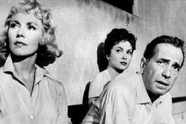 "Jennifer Jones (left), Gina Lollobrigida and Humphrey Bogart star in John Huston's ""Beat the Devil"" (1953)."