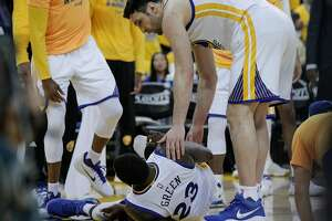 Golden State Warriors' Zaza Pachulia checks on Draymond Green in the third quarter during Game 2 of the First Round of the Western Conference 2017 NBA Playoffs at Oracle Arena on Wednesday, April 19, 2017 in Oakland, Calif.