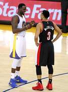 Golden State Warriors' Draymond Green and Portland Trail Blazers' C.J. McCollum exchange pleasantries in 4th quarter of Warriors' 110-81 win in Game 2 of NBA Western Conference 1st Round Playoffs at Oracle Arena in Oakland, Calif., on Wednesday, April 19, 2017.