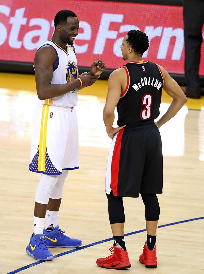 Golden State Warriors' Draymond Green and Portland Trail Blazers' C.J. McCollum exchange pleasantries in 4th quarter of Warriors' 110-81 win in Game 2 of NBA Western Conference 1st Round Playoffs at Oracle Arena in Oakland, Calif., on Wednesday, April 19, 2017. Photo: Scott Strazzante, The Chronicle
