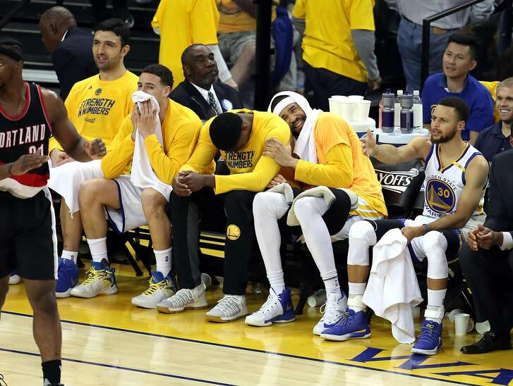 Golden State Warriors' JaVale McGee laughs at a 4th quarter turnover by Portland Trail Blazers during Warriors' 110-81 win in Game 2 of NBA Western Conference 1st Round Playoffs at Oracle Arena in Oakland, Calif., on Wednesday, April 19, 2017.