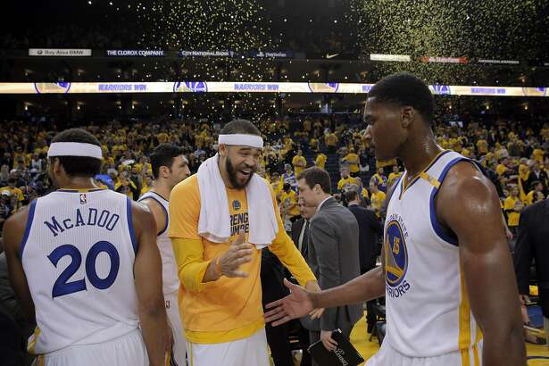 JaVale McGee (1) high fives Damian Jones (15) after the Golden State Warriors defeated against the Portland Trail Blazers in Game 2 of the first round of the NBA Playoffs at Oracle Arena in Oakland, Calif., on Thursday, April 20, 2017.