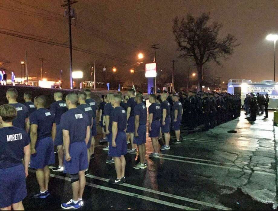 Milford police and recruits stand at attention before a run in honor of Milford Officer Dannel Wasson, who was shot and killed on April 12, 1987 while on duty. As they have done for decades, officers and recruits assemble at the Milford Police Headquarters at 4 a.m. and run to the stop where Wasson was killed on the Boston Post Road. There at the spot, a ceremony is held and a wreath placed. Photo: Milford Police Department Via Twitter / Contributed Photo / Connecticut Post Contributed