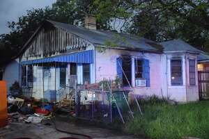 Arson investigators are examining the causes of a Thursday morning house fire, where they recently extinguished a blaze that destroyed the home's detached garage.
