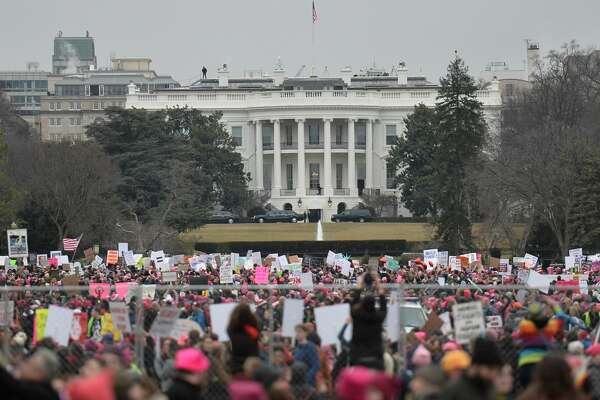 TOPSHOT - Demonstrators protest  near the White House in Washington, DC, for the Women's March on January 21, 2017. Hundreds of thousands of protesters spearheaded by women's rights groups demonstrated across the US to send a defiant message to US President Donald Trump. / AFP / Andrew CABALLERO-REYNOLDS        (Photo credit should read ANDREW CABALLERO-REYNOLDS/AFP/Getty Images)