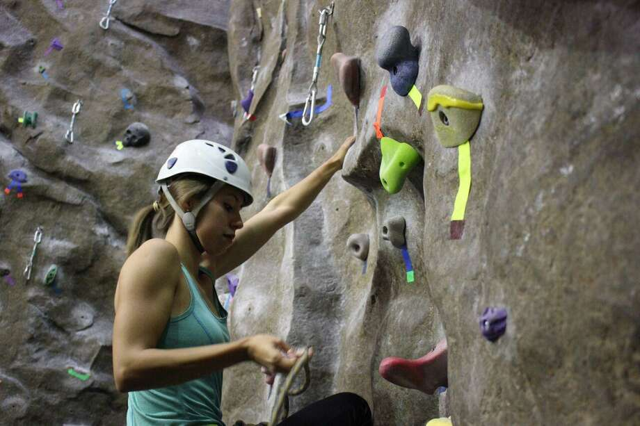 With several climbing walls and one at 54 feet being the tallest in the UT system, Outdoor Pursuits offers free climbing and equipment rental to Campus Recreation members. Photo: Courtesy Photo /UTSA