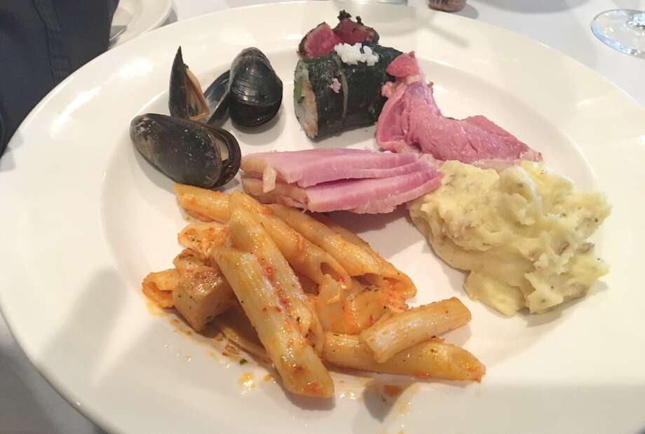 Cajun chicken pasta, mashed potatoes, ham, prime rib, shrimp sushi rolls, char crusted tuna and smoked mussels from Bristol Seafood Grill in Creve Coeur. Photo: Bill Roseberry • The Edge