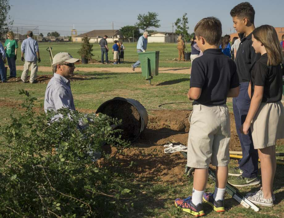 Mark Walter, with TreeKeepers, teaches Henderson Elementary fifth graders about planting a tree as they join forces with Keep Midland Beautiful, TreeKeepers and the City of Midland 04-20-17 to help plant 25 new trees in Henderson Park in celebration of Arbor Day 2017. Tim Fischer/Reporter-Telegram Photo: Tim Fischer/Midland Reporter-Telegram