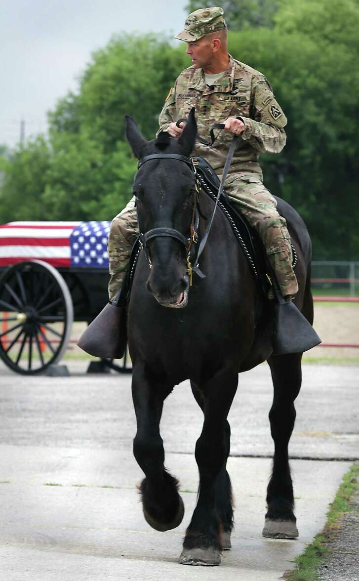 Lt. Gen. Jeffrey Buchanan, commander of U.S. Army North, rides Preston, a horse with the Caisson Section of Joint Base San Antonio- Fort Sam Houston. Buchanan will be the first general on horseback in the Battle of Flowers Parade since Gen. John Pershing in 1917, a festival spokesman said.