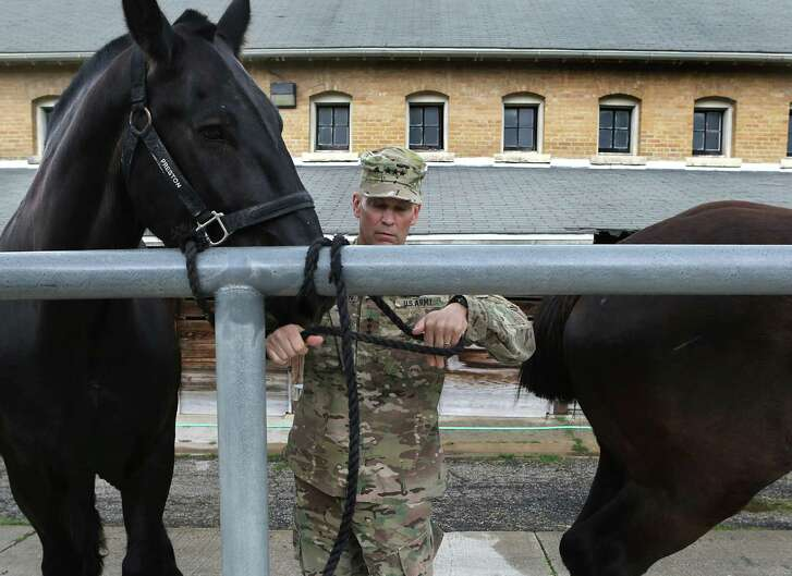 """Lt. Gen. Jeffrey Buchanan, commanding general of U.S. Army North, secures """"Preston"""" a horse from the Fort Sam Houston Caisson Section, on Monday, April 17, 2017, that he will ride in the Battle of Flowers Parade."""