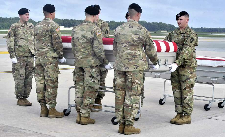 "Members of the Army ""Old Guard"" unit escort remains thought to be those of U.S. troops who died in the Mexican-American War as they arrived at at Dover Air Force Base in Dover, Del., Wednesday, Sept. 28, 2016. The remains thought to be those of U.S. troops who died in the Mexican-American War have been flown to a military mortuary in Delaware in an effort to determine whether they belonged to militia members of a Tennessee regiment known as ""The Bloody First."" (Gary Emeigh/The Wilmington News-Journal via AP) Photo: Gary Emeigh, MBO / Associated Press / The Wilmington News-Journal"