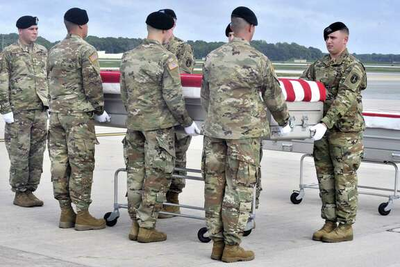 """Members of the Army """"Old Guard"""" unit escort remains thought to be those of U.S. troops who died in the Mexican-American War as they arrived at at Dover Air Force Base in Dover, Del., Wednesday, Sept. 28, 2016. The remains thought to be those of U.S. troops who died in the Mexican-American War have been flown to a military mortuary in Delaware in an effort to determine whether they belonged to militia members of a Tennessee regiment known as """"The Bloody First."""" (Gary Emeigh/The Wilmington News-Journal via AP)"""