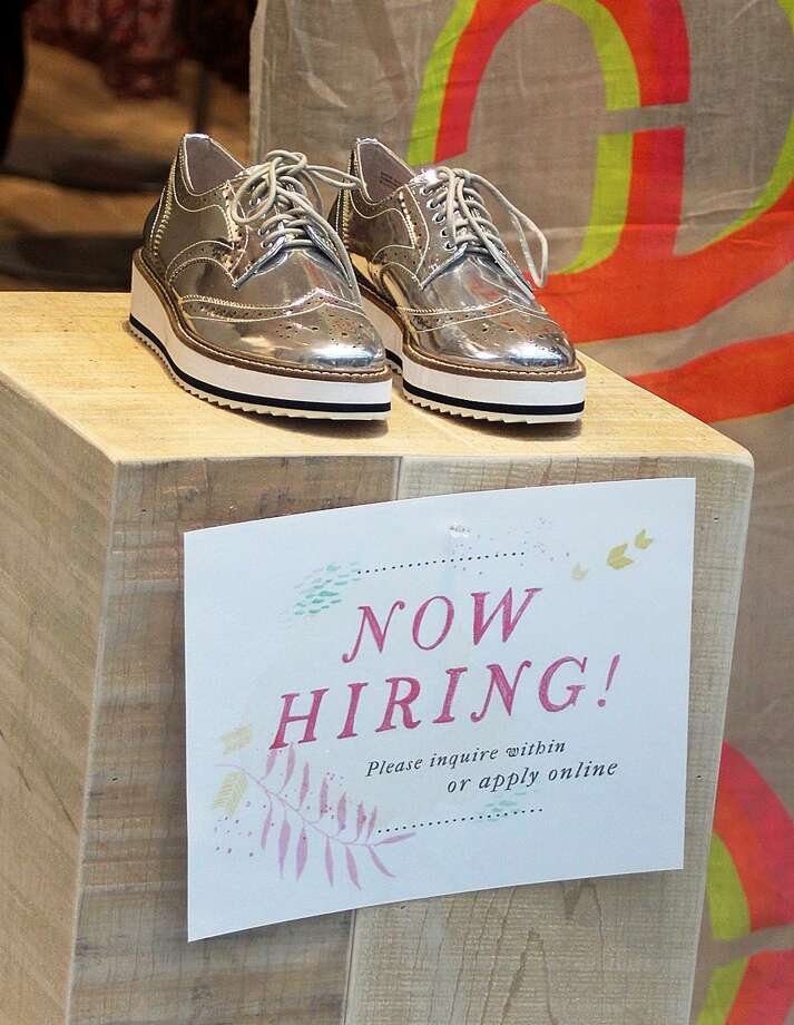 "A ""Now Hiring"" sign is shown through a display window at Free People at Danbury Fair in this photo taken Friday, Dec. 30, 2016, in Danbury, Conn. State economists are hoping for a better year for job growth in 2017. Photo: Chris Bosak / Hearst Connecticut Media / The News-Times"