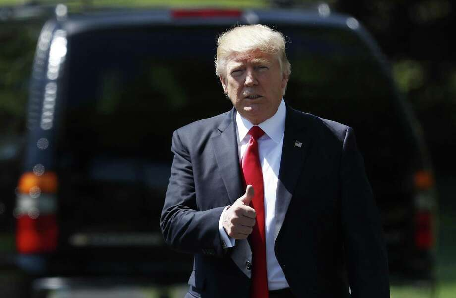 """FILE - In this Tuesday, April 18, 2017, file photo, President Donald Trump gives a thumbs-up as he walks to board Marine One on the South Lawn of the White House in Washington, for the short trip to Andrews Air Force Base, Md., en route to Kenosha, Wis. Trump, the """"America First"""" president who vowed to extricate the U.S. from onerous overseas commitments, appears to be warming up to the view that when it comes to global agreements, a deal's a deal. (AP Photo/Carolyn Kaster, File) Photo: Carolyn Kaster, STF / Associated Press / Copyright 2017 The Associated Press. All rights reserved."""