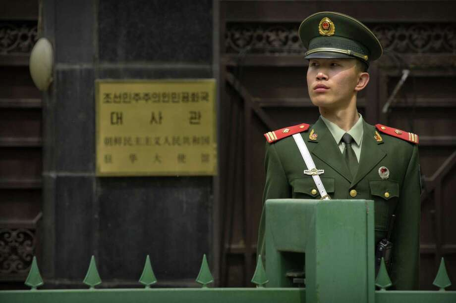 A Chinese paramilitary policeman stands guard outside of the North Korean Embassy in Beijing, Thursday, April 20, 2017. The U.S. is piling the pressure on Beijing to use its clout with North Korea to rein in its nuclear and missile programs. China is the North's most important trading partner and ally, but Pyongyang has ignored Beijing's calls for a suspension of those programs and its requests for high-level bilateral talks. (AP Photo/Mark Schiefelbein) Photo: Mark Schiefelbein, STF / Associated Press / Copyright 2017 The Associated Press. All rights reserved.