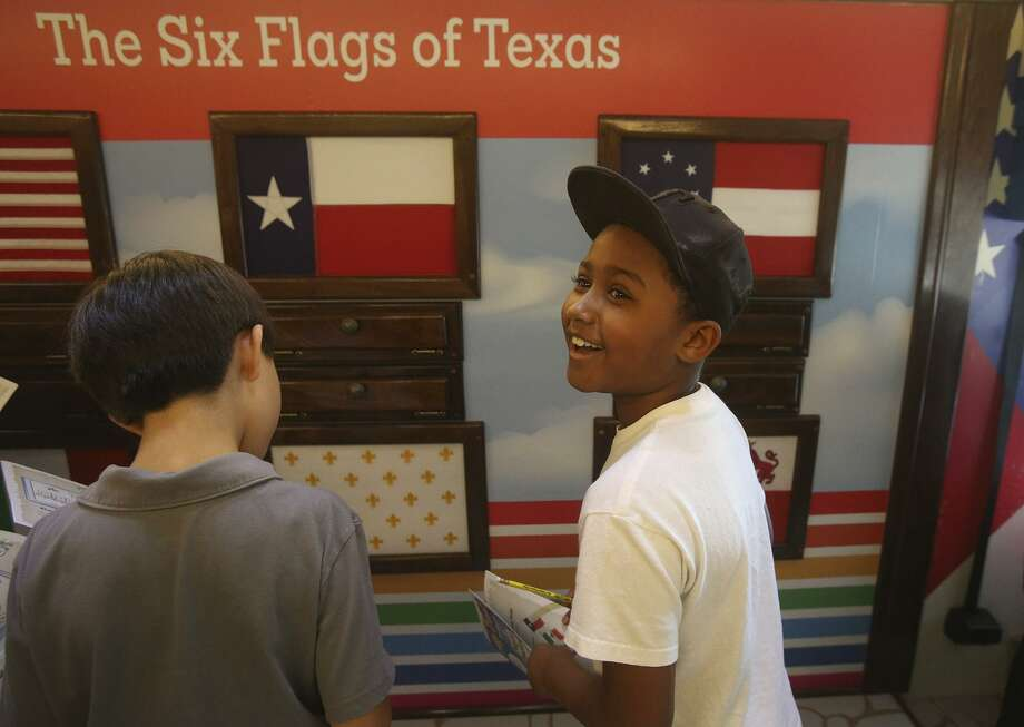 Fourth grader Micah McCants (right), 9, explores the History In Motion RV Sept. 3, 2015, at the Monte Vista Montessori School. The 44-foot RV visits area schools and allows students to interact with different stations about local and Texas history. More info on requesting a visit: http://extras.mysanantonio.com/_CreativeServices/_marketing/history-in-motion/him-form.html Photo: John Davenport /San Antonio Express-News / ©San Antonio Express-News/John Davenport