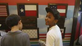 Fourth grader Micah McCants (right), 9, explores the History In Motion RV Sept. 3, 2015, at the Monte Vista Montessori School. The 44-foot RV visits area schools and allows students to interact with different stations about local and Texas history. More info on requesting a visit: http://extras.mysanantonio.com/_CreativeServices/_marketing/history-in-motion/him-form.html