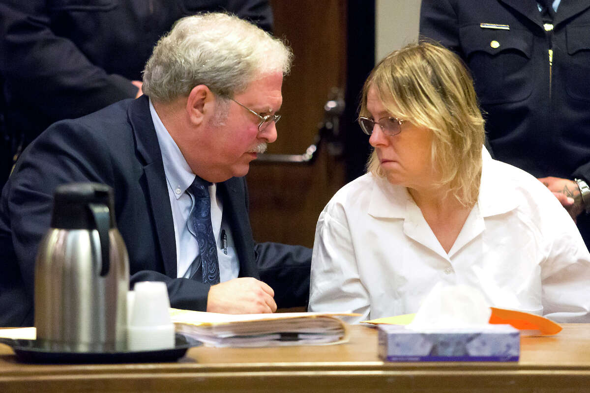 Attorney Steven Johnston, left, confers with Joyce Mitchell, a former prison employee who provided the tools that two murderers used to cut their way out of a maximum-security facility in northern New York, during a restitution hearing at the Clinton County Government Center, Friday, Nov. 6, 2015, in Plattsburgh, N.Y. Mitchell's will pay $79,841, plus a 10 percent surcharge, for the damage Richard Matt and David Sweat caused by using hacksaw blades and other tools she provided to break out of Clinton Correctional Facility in June, a prosecutor said. (Gabe Dickens/Press-Republican via AP)