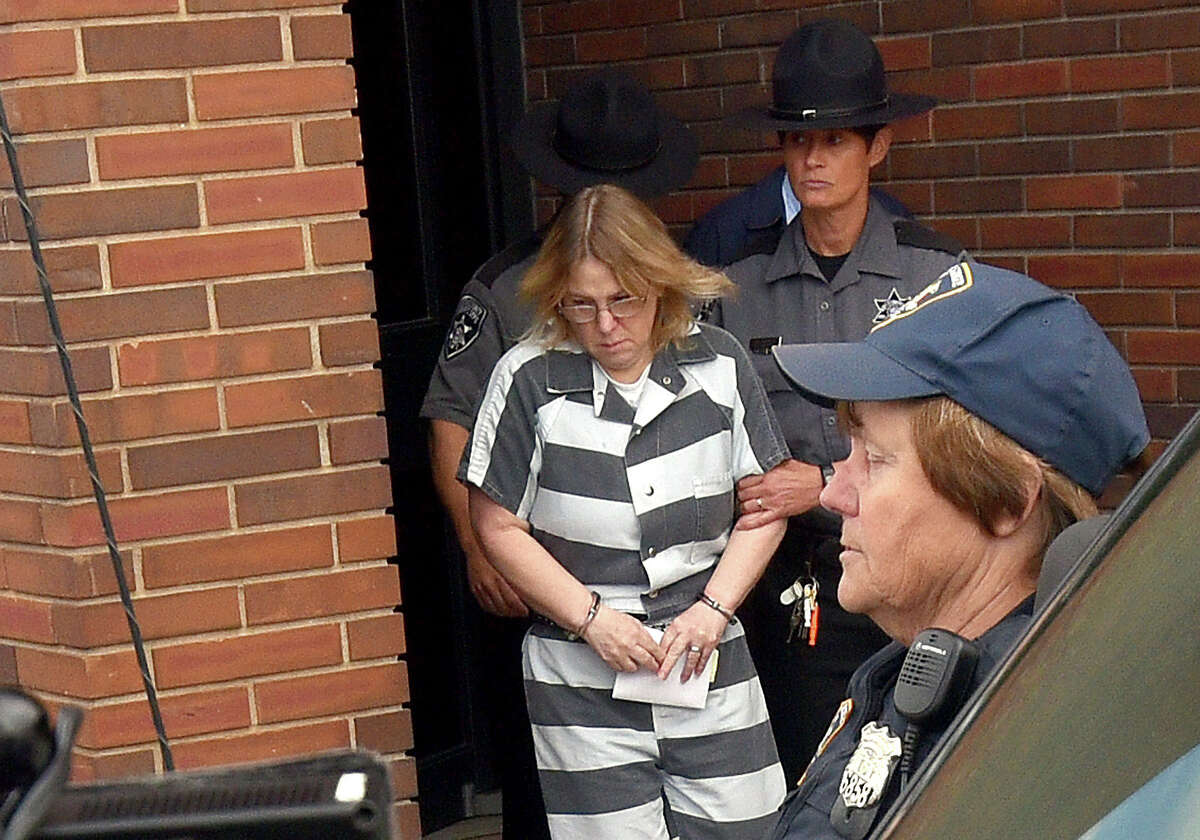 Joyce Mitchell leaves Clinton County Court after being sentenced, Monday, Sept. 28, 2015, in Plattsburgh, N.Y. Mitchell, who helped two convicted murderers escape from a maximum-security lockup by providing them with tools, was sentenced to up to seven years behind bars. (Rob Fountain/Press-Republican via AP) MANDATORY CREDIT ORG XMIT: NYPLA105