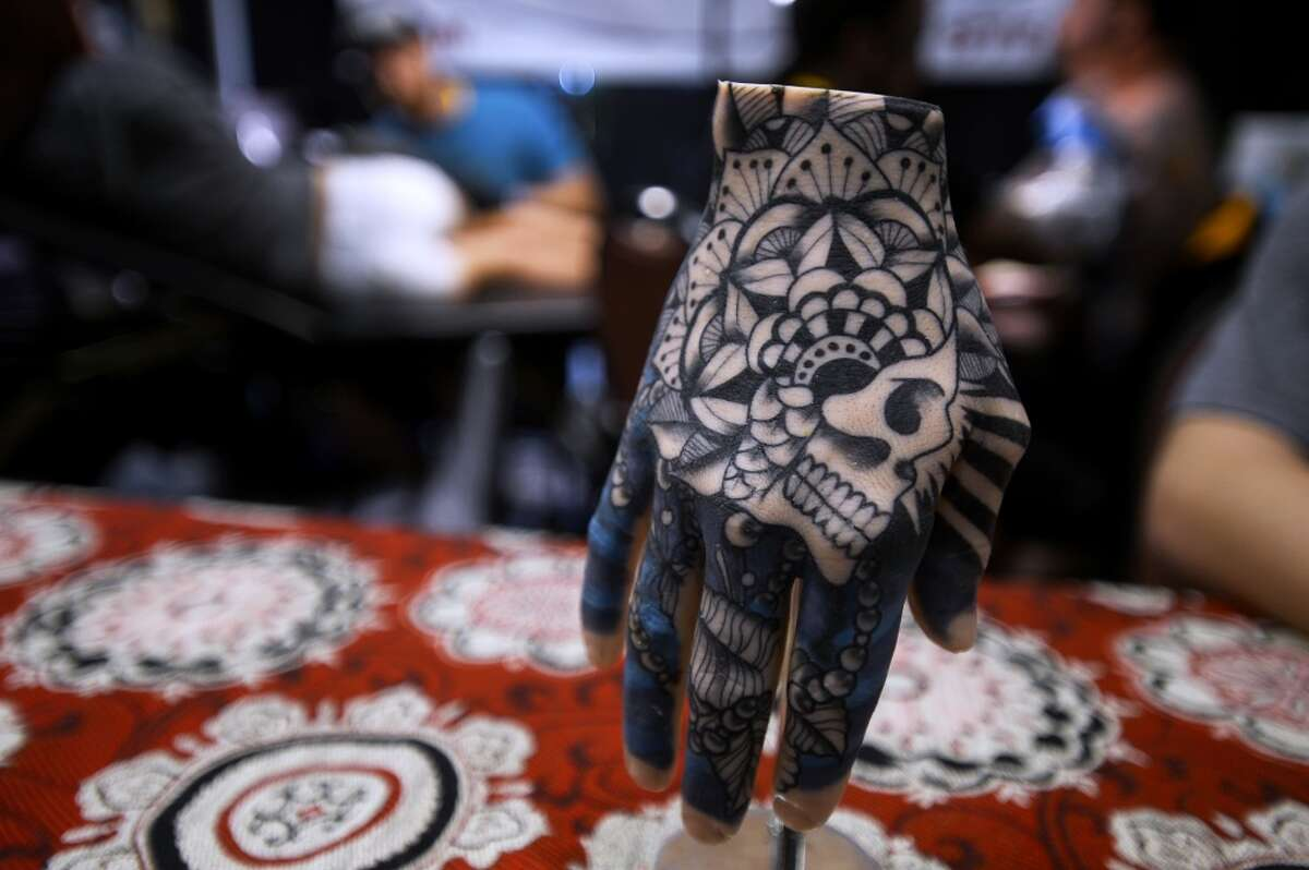 A tattooed fake hand on display during a tattoo expo. The company Save My Ink Forever specializes in preserving tattoos from deceased family members. Three funeral homes in Texas offer the service.