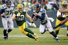 GREEN BAY, WI - DECEMBER 11:  Clay Matthews #52 of the Green Bay Packers chases after Russell Wilson #3 of the Seattle Seahawks in the first quarter at Lambeau Field on December 11, 2016 in Green Bay, Wisconsin. (Photo by Dylan Buell/Getty Images)