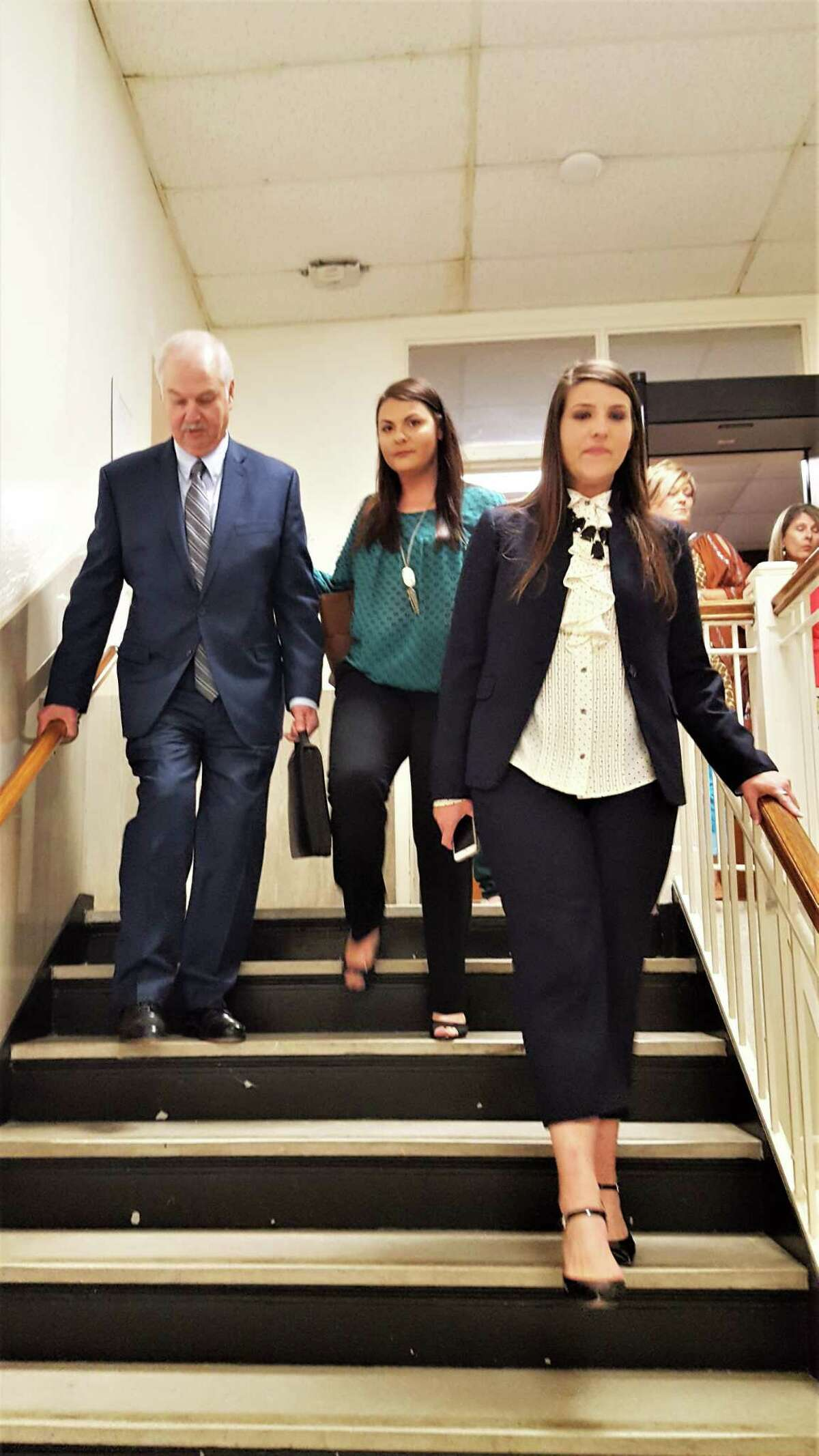 Liberty County Pct. 1 Commissioner Mike McCarty leaves court Wednesday afternoon with his two daughters Kirsti and Katherine. McCarty was feeling a little better after the prosecution rested and the defense began calling its witnesses to the stand.