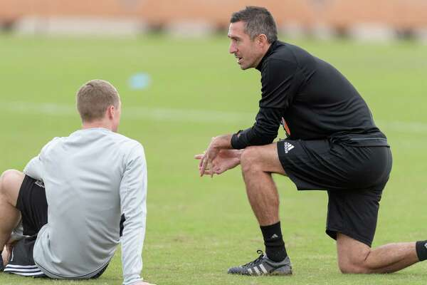 Newly hired assistant coach Davy Arnaud interacts with players on the first day of the Houston Dynamo's practice at Houston Sports Park on Jan. 25. A Nederland High School graduate, Arnaud appeared in 351 career regular-season games, eighth among field players in MLS history, and registered 50 goals and 46 assists. (Wilf Thorne/Houston Dynamo)