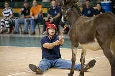 Greg Wells with the Midland Fire Department begs his donkey to move Tuesday night during the departments Donkey Basketball game against the Midland Police Department at the Chaparral Center. The City of Midland and Midland College sponsored basketball Tournament to raise money for the United Way. Cindeka Nealy/Reporter-Telegram