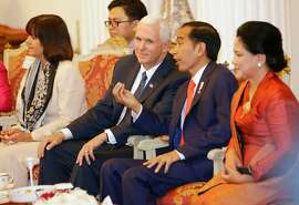 US Vice President Mike Pence (2nd-L) talks with Indonesian President Joko Widodo (2nd-R) as Pence' wife Karen (L) and Widodo's wife Iriana listen during their meeting at Merdeka Palace in Jakarta on April 20, 2017.  Pence to visit the largest mosque in Indonesia -- the world's most populous Muslim-majority nation -- a symbolic gesture for the deputy in an administration accused of stoking Islamophobia / AFP PHOTO / POOL / Dita AlangkaraDITA ALANGKARA/AFP/Getty Images