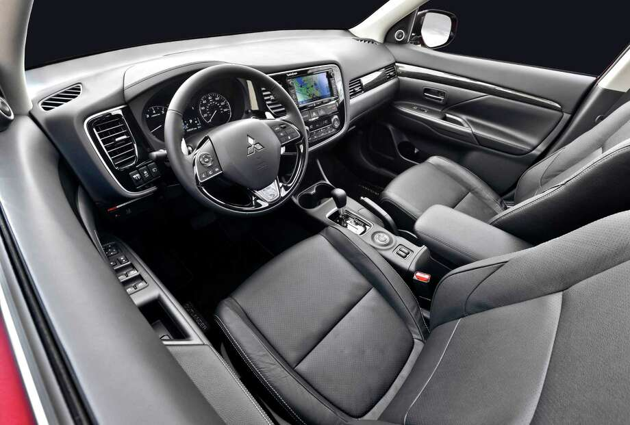 The Mitsubishi Outlander was updated last year with a reconfigured interior including a redesigned steering wheel, improved second-row seating, accent trim, and revised seating surfaces and headliner, among other new features. Photo: Mitsubishi / Copyright 2015