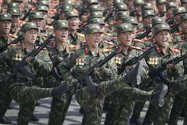 FILE - In this April 15, 2017, file photo, soldiers march across Kim Il Sung Square during a military parade in Pyongyang, North Korea, to celebrate the 105th birth anniversary of Kim Il Sung, the country's late founder and grandfather of current ruler Kim Jong Un. North Korean fury at Washington was rising well before U.S. President Donald Trump took office, in particular over reports that annual U.S.-South Korean military exercises now include training for precision strikes on the North's leadership or nuclear and military facilities. (AP Photo/Wong Maye-E)