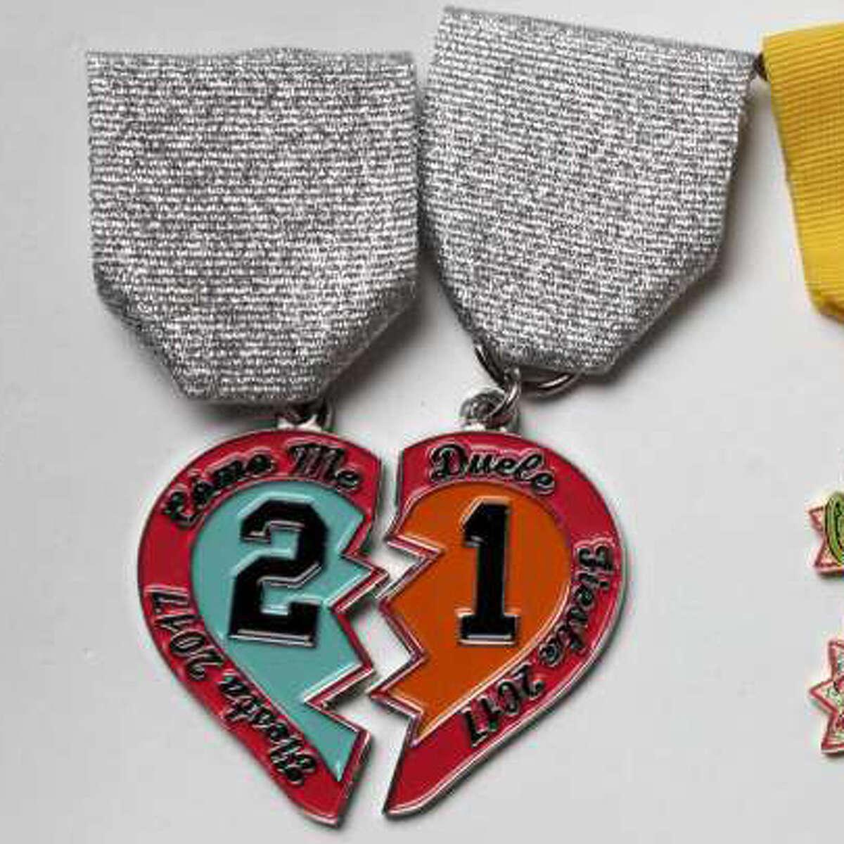 "SA Flavor Broken Heart Â?""Como Me DueleÂ?"" pair of medals, $20, saflavor.com, $2 of every sale goes to Sam Houston High SchoolÂ?'s government mock trial team"