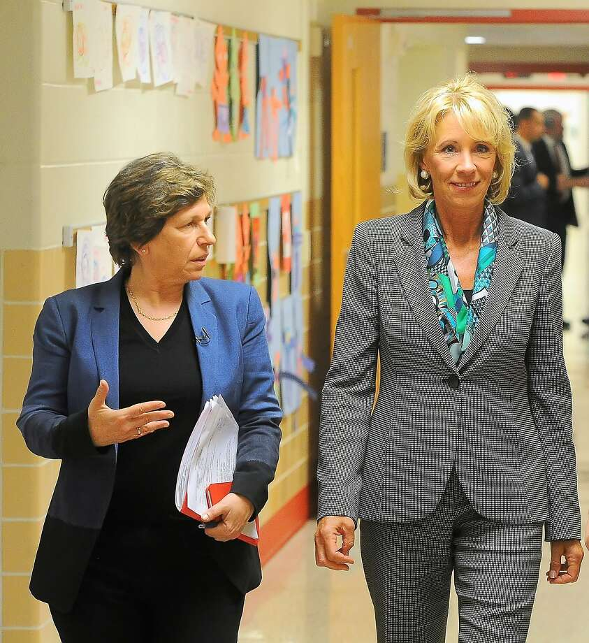 American Federation of Teachers President Randi Weingarten (left) and Education Secretary Betsy DeVos walk down a hallway during a visit to northwestern Ohio's Van Wert High School. Photo: Richard Parrish, Associated Press