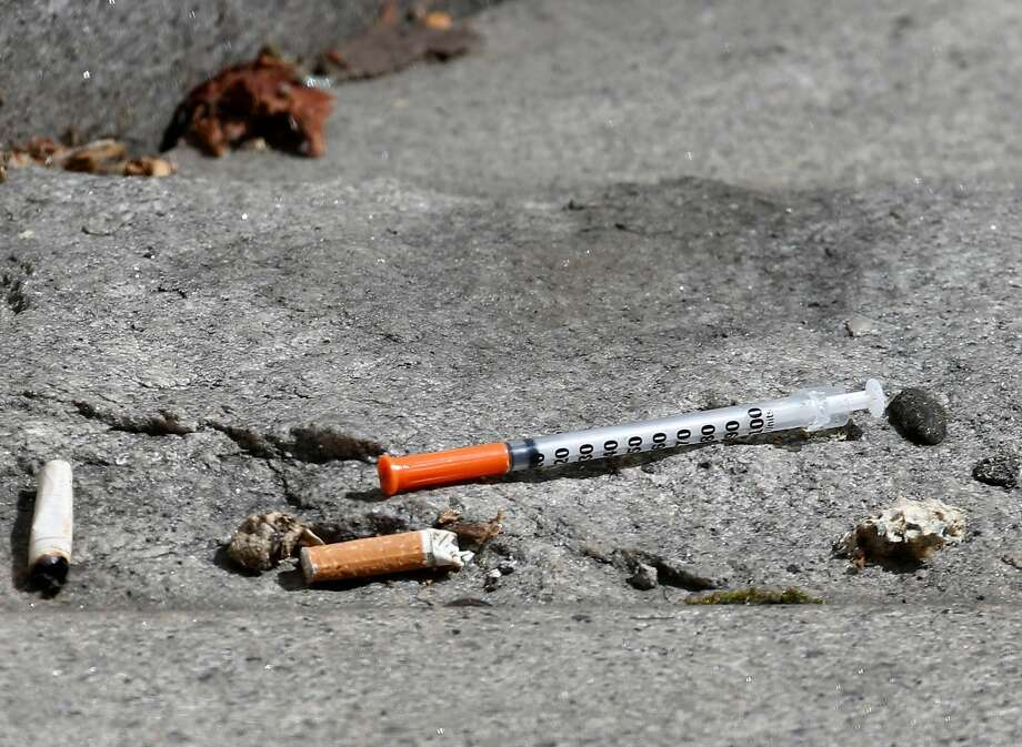 A used needle is discarded at the Civic Center BART station. The city is considering becoming the first in the United States to open a safe injection site for injection drug users. Photo: Paul Chinn, The Chronicle