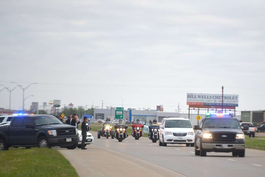 Representatives of the Plainview Police Department salute while standing by patrol units on the side of I-27 as a group of Patriot Guard Riders, escorted by dozens of emergency vehicles, pass by the south city limits about 9:15 a.m. Thursday. The Patriot Guard Riders were escorting the cremains of five veterans from Amarillo to Ft. Sam Houston National Cemetery in San Antonio for military rites on Friday. The veterans – three from the Vietnam War (one Army and two Air Force), one from Korean War (Air Force) and a Navy veteran, died with no known family. Their remains have gone unclaimed for several years. To show their respect, the Patriot Guard Riders will stand as their family on Friday. Escorting the nearly mile-long procession through Plainview were local police units, the Hale County Sheriff's Department also serving as escort while the caravan traveling through Hale County.