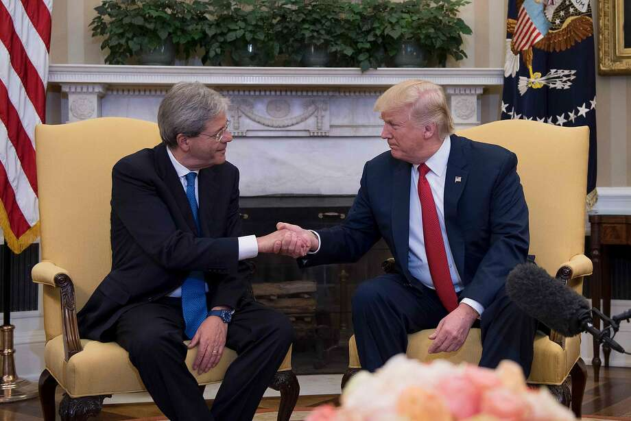 President Trump shakes hands with Italian Prime Minister Paolo Gentiloni at the White House. Trump will be traveling to Italy next month for the Group of Seven meeting. Photo: JIM WATSON, AFP/Getty Images
