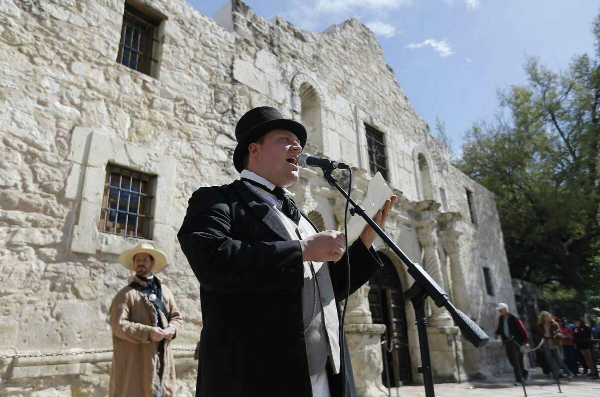 """Tim Hicks dresses in period clothing as he reads a portion of the Texas Declaration of Independence in front of the Alamo on Thursday, Mar. 2, 2017. The Alamo may get its own day on the calendar under a proposed state law. State Rep. Diego Bernal and Sen. José Menéndez, both San Antonio Democrats, have joined Rep. Jason Villalba, R-Dallas, in sponsoring a bill declaring March 6, the anniversary of the 1836 battle that ended a 13-day siege, to be recognized annually as Alamo Day. ?""""Alamo Day will celebrate the importance of Texan fortitude in pursuit of a goal?...?"""" Villalba said in a release. During the ceremony on Thursday at the Texas shrine, the signing of the Texas Declaration of Independence in East Texas on March 2, 1836 was commemorated. The document, declaring Texas an independent republic, was signed as Mexican Gen. Antonio López de Santa Anna sought to reclaim the Alamo and San Antonio de Béjar. The link between the Alamo and the declaration 100 miles to the east, at Washington on the Brazos, is often illustrated through a letter that William Barret Travis, Alamo commander, wrote and dated March 3. (Kin Man Hui/San Antonio Express-News)"""