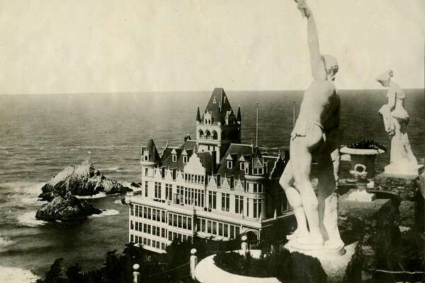 This is the third San Francisco Cliff House, built in 1894, and burned in 1907. The statues are on the parapet of Sutro Heights